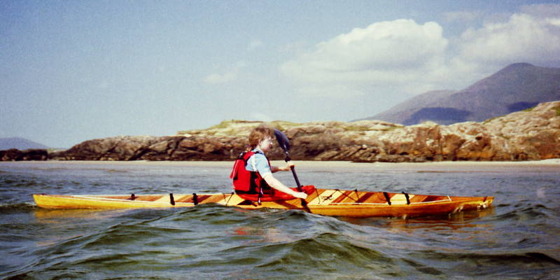 Mary (~45 kg, 1.6m) paddling in small Atlantic waves