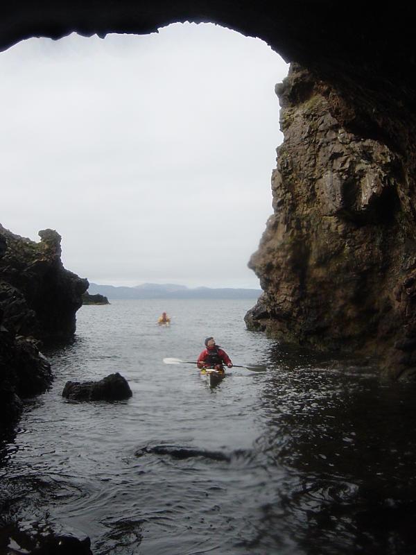 Exploring one of the sea caves on the wild coast of the Sleat peninsula. Photo: Andy Waddington.