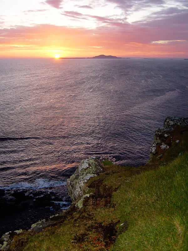 The sun sets behind Lunga five and half miles away from the cliffs of Staffa. Photo: Andy Waddington.
