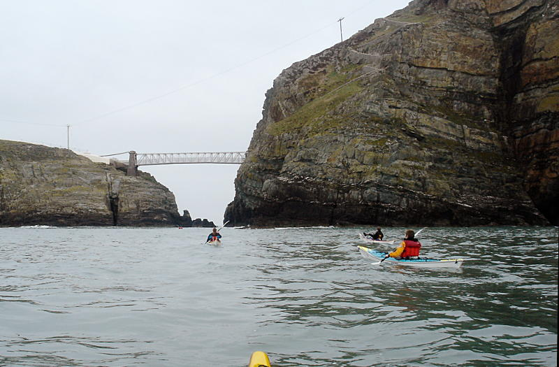 Paddling north with the tide towards the gap under the South Stack bridge. Photo: Andy Waddington