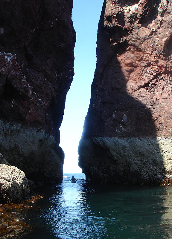 A narrow cleft below St. Abbs lighthouse - exciting to paddle in any swell