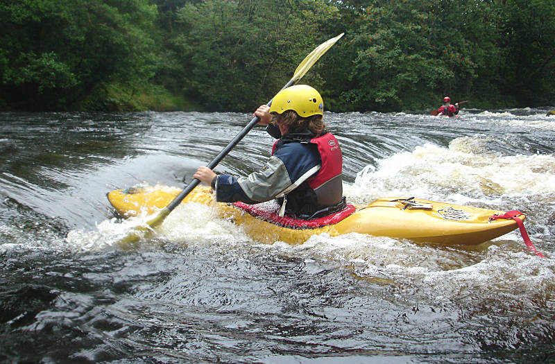 Michael surfing a playwave on the Lower Tryweryn
